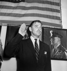 On August 12, 1942, looking haggard, with his hair flopping in his face and a sad look in his eyes, Clark Gable was sworn into service to the United States Army, wearing the same suit he had worn to his wife's funeral months before.