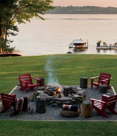 backyard fire pit. gravel around + framed with adirondack chairs.