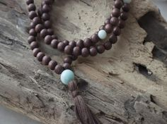 Pause Mala - 108 wooden bead mala necklace. It isbelieved that, withthe repetition of your personal mantras, your mala stores your spiritual energy.May this become a treasured piece in your meditation practice. May your mala become infused with your intentions and serve as a gentle reminder to take time every day to pause and be grateful. A reminder to strive to keep your energy positive! Wooden Bead Necklaces, Wooden Beads, Perfect Gift For Her, Gifts For Her, Turquoise Necklace, Beaded Necklace, Yoga Jewelry, Grateful, Meditation