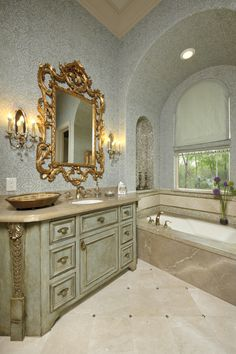 Designed to complement the guest suite, beautiful attention to detail was placed into the vanity. Recessed niches lined with mosaic tile are set within the arched ceiling walls containing the tub, providing space for toiletries or candles to add to the soothing atmosphere.
