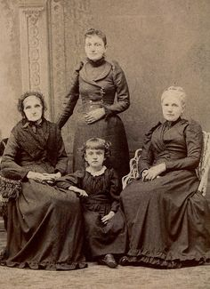 Four generations of Victorian women, apparently in mourning.