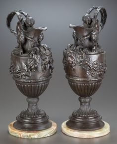 A NEAR PAIR OF BRONZE WINE AND WATER EWERS ON MARBLE BASES, AFTER SIGISBERT-FRANCOIS MICHEL