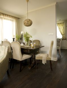 dining room with vintage table, elegant upholstered chairs and the hand-made lamp