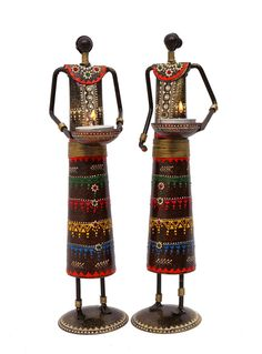 These showpiece figurines will usher into your surroundings an aura of elegance. Tea Light when placed in the bows convert these artifacts into an exquisite decoration items.  (There may be very MINOR VARIATIONS in color combinations and figure designs, between displayed and dispatched products, due to variety of artisans who handcraft the products. The look, feel and quality will , however, be consistent with what you see. That is an Indikala promise).