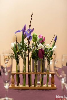 Test tubes filled with locally grown flowers for a science themed wedding!