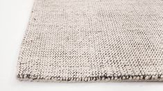 Soft greys and beige are intertwined with a thick black stitch in this 80% wool, 20% linen rug.  Rug pad recommended, sold separately Made in India