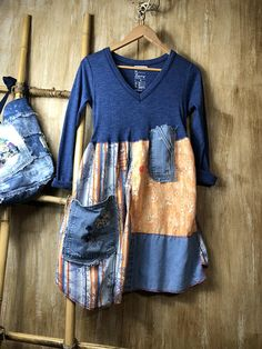 Love this sweet dress/tunic, so cute on any time of year. On its own or with your favorite pair of jeans! Soft t shirt on top and cotton and denim on the bottom. So figure flatter and comfortable easy to wear all day long. One of a kind, lots of funky stitching and patchwork with