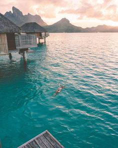 Sunset from our overwater bungalow at Four Seasons Bora Bora for our honeymoon v. Sunset from our overwater bungalow at Four Seasons Bora Bora for o. Vacation Places, Vacation Destinations, Dream Vacations, Vacation Spots, Tahiti, Four Seasons Bora Bora, Overwater Bungalows, Beautiful Places To Travel, Jolie Photo