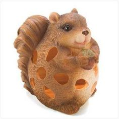 Chubby chipmunk chuckles with glee as he holds his treasured acorn for all to see! Adorable solar powered light adds a bit of woodland whimsy to your favorite outdoor space.