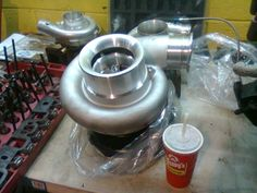 Borg Warner SX500 - Really big turbo going on a customer's Fox Body Mustang... That's a medium Wendy's cup next to it.