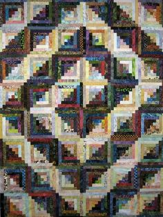 I have seen a lot of log cabin quilts but this is an interesting use of light and dark.