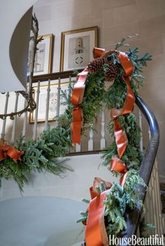 large spruce-and-juniper garland dressed with pinecones and ribbons.