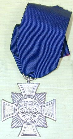 This is a World War II German Danzig Cross 2nd Class with Ribbon. This is a very hard to find medal.