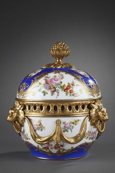 A beautiful soft porcelain pot-pourri in the taste of Sèvres with gilt bronze mounts and polychromatic decoration composed of bunches of flowers on white and blue background hightened with..