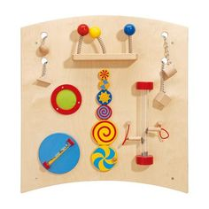 Gressco HABA® Learning Wall - Curve B. Love the idea of spinning 'tubes'. Could fill sensory bottles with all different items on one panel and have them all spinnable.