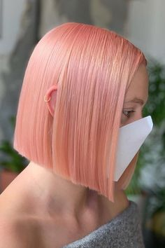 Looking for that perfect edgy pastel hair color? Then you might consider this rosy apricot blunt bob hair created by precision cutting & colour specialist Flossie Lilley (@thehairflossie). Tap to visit our site and see our list of chic blunt bob haircuts and hairstyles. #bluntbobhaircuts #bluntbobhairstyles