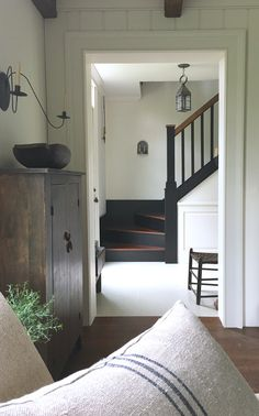 love this simple farmhouse style old house entryway & stairway