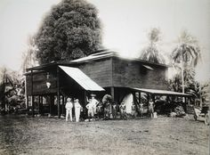This photo of a copra dryer at the Mulifanua Plantation from about 1915. The men on the left are (left-to-right): Mr Alan R.Cobcroft, Mr John Helg the plantation manager, Mr Friz Jahnke and Mr Uati Rasmussen behind.Credit: Tattersall, Alfred James, 1866-1951. Copra drier, Samoa. Ref:  PACOLL – 3063-06. Alexander Turnbull Library, Wellington, New Zealand