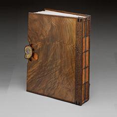 "Mark Doolittle. ""Walnut Book"" (Back) 13""h x 10""w x 2""d. Claro Walnut with inlayed fossil Ammonite. Binding by Kathy Doolittle."