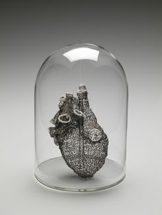 """Mixed-media sculptor Anne Mondro says, """"My creative work explores the physical and emotional complexity of the human body."""" Using a crochet technique that uses thin-gauge wire, she crafts body parts such as a heart or lungs. While light in weight, the forms' delicate appearance belie their own structural strength. They stand as elegant and ethereal forms that speak to the ghosts of our selves. The artists is currently a professor at the University of Michigan in Ann Arbor. In the video…"""