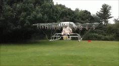 "Watch This Guy Fly In A 54-Propeller Super Drone - 					  Flying drones are all the rage right now. The latest DJI Phantom is smoking hot. But sitting in your very own one and flying it? That's uncharted territory…until now. Check out this dude in the UK hovering above the earth in a contraption with ""54 counter-rotation... 