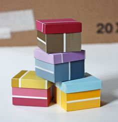 Gift boxes made from paint chips.
