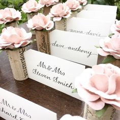 Exclusive wedding Place Card Holder by Kara's Vineyard Wedding. Vintage wine corks & handmade flowers. Featured in over 2,000 weddings worldwide!