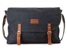 Caler Bags by JUSTINE. This postman bag look so classy, with laptop sleeve, with magnet fastening, Twin buckle and strap. This blue bag wit brown strap is sure look simply stylish, suitable for everyday use.    IDR. 301.000