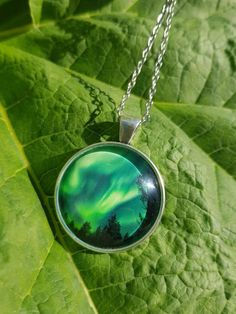 Necklace with my photography of the northern lights. Taken by me at Balsfjord, Norway. Star Photography, Nature Photography, Handmade Necklaces, Handmade Items, Holidays In Norway, Types Of Rings, Northern Lights, How To Find Out, Jewelry Making
