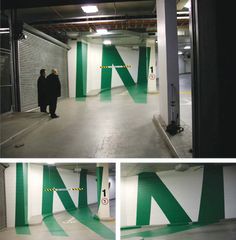 Concept developed by Axel Peemoeller.  Eureka Tower Carpark in Melbourne.    Apparently a projector was used to light up the words onto the 3D space, the outlines were traced and the designers simply painted inside the lines.