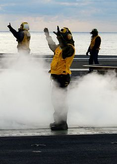 Flight deck directors aboard the aircraft carrier USS George H.W. Bush direct planes on the ship's flight deck. (U.S. Navy photo by Mass Communication Specialist 3rd Class Kevin J. Steinberg/Released)