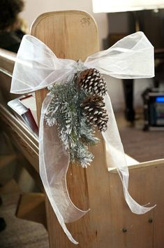 Pinecone and fir wedding aisle decor | An Enchanting Winter Wedding in Ste-Adele, Quebec | Weddingbells #ChairWedding