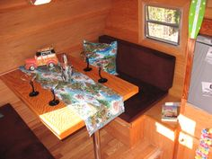 Booth Table - Rear Bed 1957 Woodie Love Bug 12′ Restored Vintage Trailer