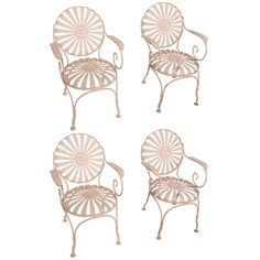 1930  1930's garden sprung steel armchairs designed by Francois Carre. Each chair with sunburst seat and back with button centers and rolled armrests with decorative scroll.