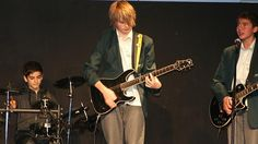 michael (centre) and Calum (right) during a school concert at Norwest Christian College. Pho