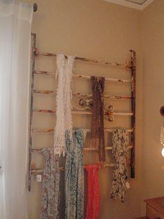 decorative metal railing re-purposed as scarf storage