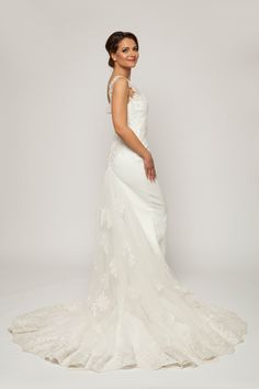 bridal dress, bridal dress with train, bridal dress with tulle train, bridal illusion neckline dress, bridal ivory dress, bridal lace hand-sewn dress, bridal mermaid dress, bridal off-shoulder dress, bridal princess dress, bridal see-through dress, bridal sleeveless dress, embroidered wedding dress, illusion neckline wedding dress, ivory dress, ivory wedding dress, lace hand-sewn wedding dress, lace wedding dress, mermaid wedding dress, sleeveless wedding dress, tulle wedding dress