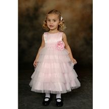 Baby Flower Girl Dress style i423t by Sweetie Pie Collection has a peau satin bodice with scoop neckline. A fulle 5 layer tulle skirt, one over sized rose on the front waist, and 2 over sized roses on back waistline. www.SweetiePieCollection.com