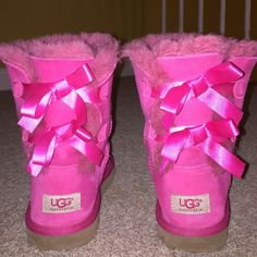 Pink Bailey bow uggs! Worn twice, a little discoloration is shown in the third picture when I tried to wash them..  They could easily fit size 8 in women's! UGG Shoes