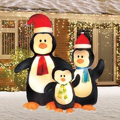 6' Tall Airblown Merry Penguin Family Christmas Inflatable  IT'S OUR FAMILY! ...As inflatable penguins!! I really wanna get this!