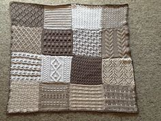 Knit sampler afghan with 12 different squares/stitch patterns