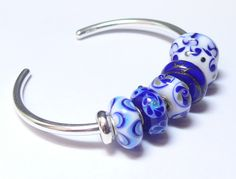 Some of our favorite Blue Assorted Trollbeads on the new Trollbeads Bangle Bracelet