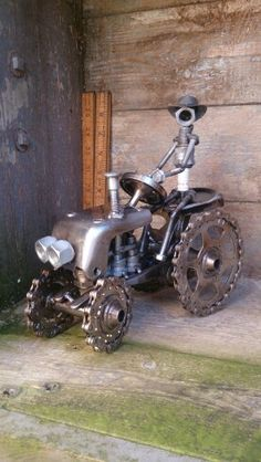 Recycled machine parts sparkplug character tractor