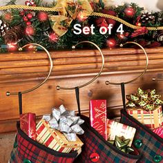 BRASS STOCKING HOOKS  Classic, brass hangers bring back the nostalgic charm of Christmases past. Uniquely shaped stocking hook balances on your mantle or table and the more weight it supports, the more stable it becomes - perfect for present-stuffed stockings!