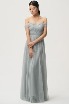 Jenny Yoo Bridesmaids, the convertible Julia dress features back tie panels and detachable straps that can be used to create different necklines. The bodice features a strapless sweetheart neckline and gathering detail. A-Line skirt creates a slimming look. The long circle skirt gives the dress a soft and beautiful sweep. Shown in Morning Mist Blue, available in over 25 colors.