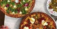 Tacopizza med tacosfärs, jalapeños och nachochips och Cypernpizza med paprika, fetaost, pesto och soltorkade tomater.