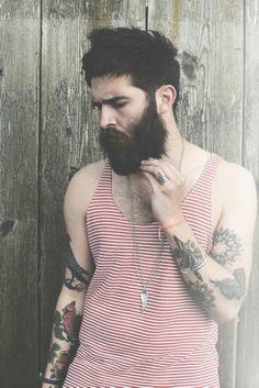 Nice beard... Don't like the tank top, but the beard is tip top...