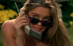 alicia silverstone wearing vintage sunglasses