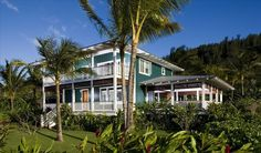 The verandas, trim details, and colors make this Hawaiian Style.  Good way to doll up a plain boxy house.