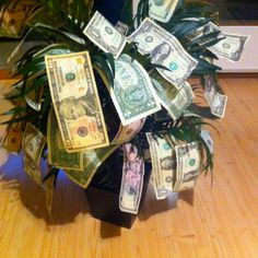 Money tree! We just made this for my step-brother. Who says money can't grow on trees? This was a great gift idea. :)